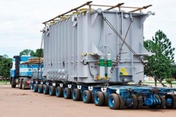 Por que cargas indivisíveis com peso concentrado devem ser transportadas em veículos especiais?